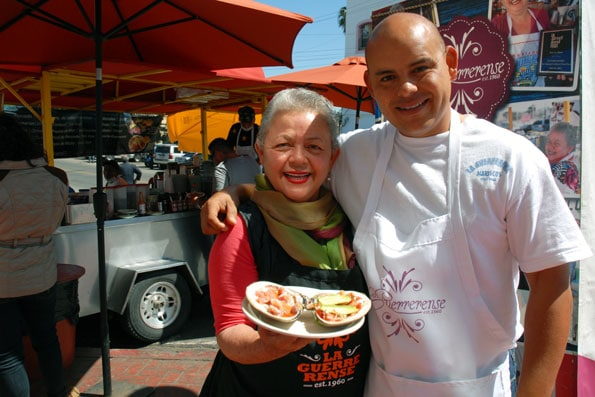 Sabina Bandera with her son Luis Edgar at their famous tostada food cart, La Guerrerense,