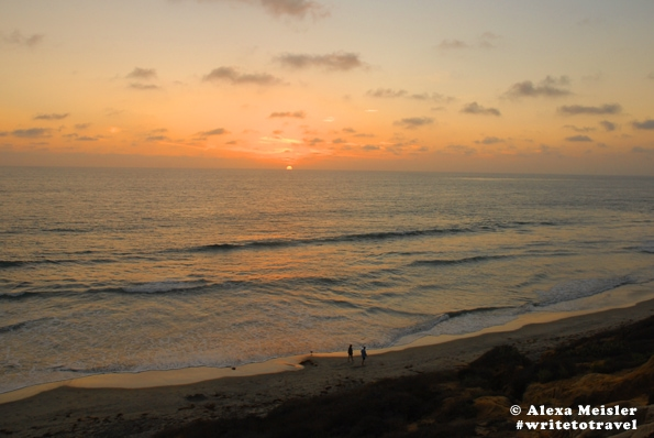 Walk on the beach in carlsbad at sunset.