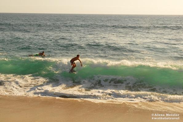 Surfers at Ponto Beach in Carlsbad, California